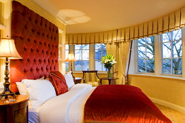 UK, Northern Ireland, Fermanagh, Enniskillen. The bedroom of The Dovecot Suite at Lough Erne Golf Resort looks out over the lake.