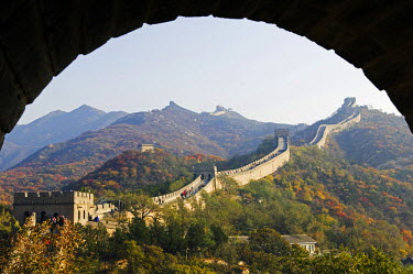 CH2277 China, Beijing, The Great Wall of China at Badaling near Beijing. Autumn colours seen through an arch.