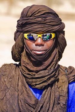 MAL0459 Mali, Douentza. A cool dude! A Bella man wearing a turban and reflective sunglasses. The Bella are predominantly pastoral people and were once the slaves of the Tuareg of Northern Mali.