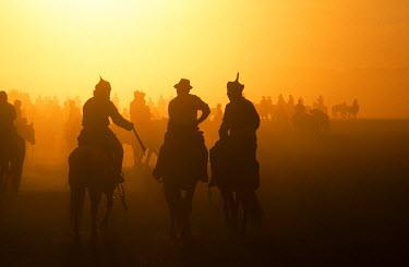 MON1225 Mongolia, Karakorum. Horse Herders returning home after a Horse Festival in Karakorum.