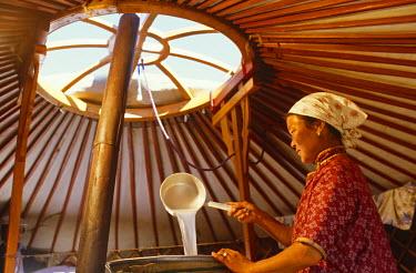 MON1220 Mongoli, Gobi Desert. Cooking Horses Milk to produce the spirit, Arak, in the Gobi Desert.