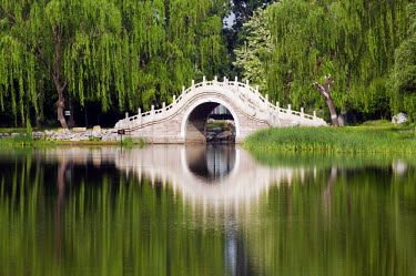 CH2302 China, Beijing. Old Summer Palace - an arched stone bridge.