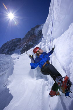 Ice climbing while practicing crevasse rescue on the Argentiere Glacier, Chamonix, France