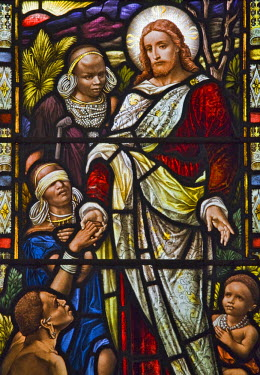 KEN5960 Kenya, Kiambu, Kikuyu. One of the stained glass windows in the Church of the Torch near Kikuyu depicts Jesus and his flock of Kikuyu women and children in traditional attire.  The church is the oldest...
