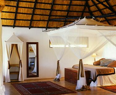 ZAM3457 Zambia, South Luangwa national park. Bedroom of Honeymoon suite, Kapani Lodge.