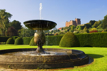 WAL6897 Wales; Powys; Welshpool. A stone fountain in the spectacular Italianate garden at  Powis Castle