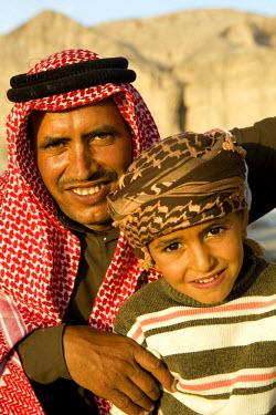 JOR0140 Jordan, Finan.   Beduin family smile and pose for the camera.