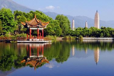 CH2707 China, Yunnan province, Dali Town. Three Pagodas and pavilion reflected in a lake at Chongsheng Temple