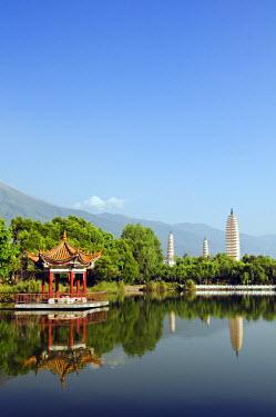 CH2708 China, Yunnan province, Dali Town. Three Pagodas and pavilion reflected in a lake at Chongsheng Temple