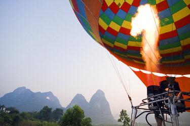 CH2788 China, Guangxi Province, Yangshuo near Guilin. A hot air balloon ride over karst limestone mountain scenery