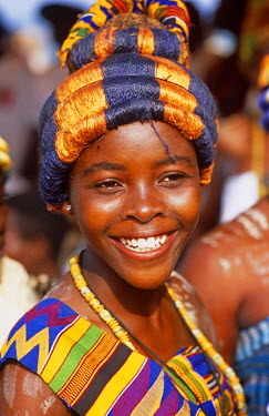 GHA0066 Ghana, Central region, Elmina. Girl in headress at Edina Bakatue festival.