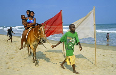 GHA0076 Ghana, Greater Accra, Accra. Labadi beach is Accra's premiere beach - horse rides are one of the attractions.