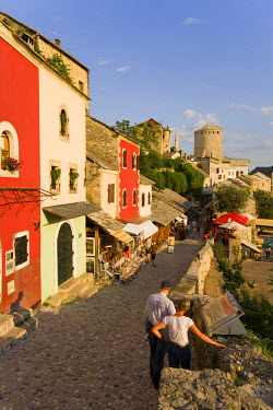 BH01011 Cobbled street lined with colourful houses, Mostar, Bosnia and Herzegovina