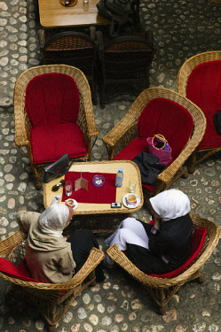 BH01059 Bosnia and Herzegovina, Sarajevo, Morica Han Coffee House-Muslim women having Coffee