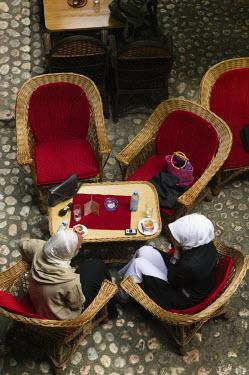 BH01059 Bosnia and Herzegovina, Sarajevo, Morica Han Coffee House-Muslim women having Coffee