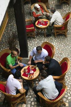 BH01060 Bosnia and Herzegovina, Sarajevo, Morica Han Coffee House-Men having Coffee