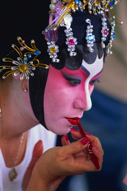 TPX9400 China, Hong Kong, Portrait of Chinese Opera Actress Applying Make-up