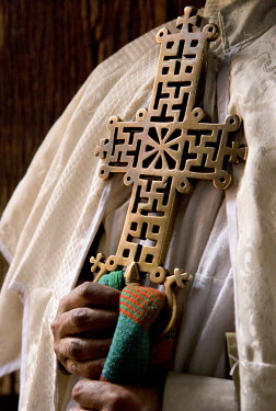 EH01021 Church Priest holding a Lalibela Cross, Lalibela, Ethiopia
