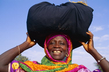 TPX5351 African Woman Carrying Bundle on Head, Banjul, Gambia
