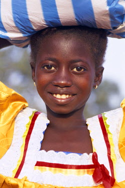 TPX5352 African Girl Carrying Sack on Head, Banjul, Gambia