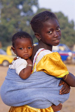 TPX5358 African Girl / Child Carrying Baby on Back, Banjul, Gambia