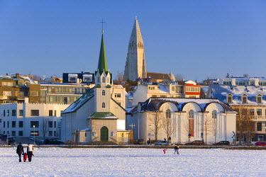 IC01043 Frikirkjan church & Hallgrimskirkja church, Lake Tjorn, Reykjavik, Iceland
