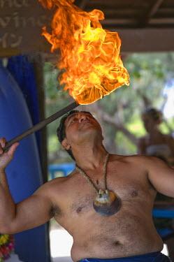 NC01094 New Caledonia, Amedee Islet, Polynesian Fire Dancer
