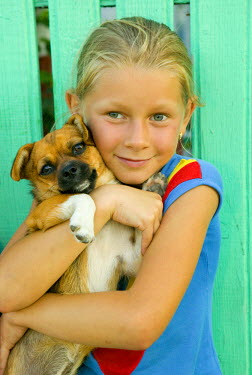 RM01028 Girl & dog by green fence, Danube Delta, Romania