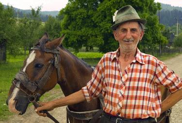 RM01049 Man with horse, Moldavia, Romania