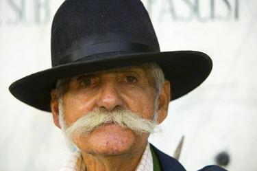 RM01101 Gypsy man in black hat, Transylvania, Romania