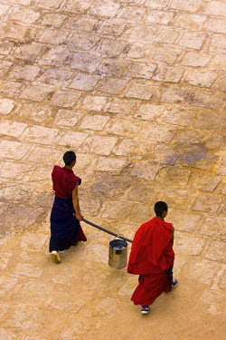 TB01043 Monks carrying yak butter, Ganden Monastery, Tagtse county, Tibet