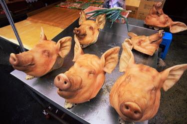 TPX7325 Korea, Busan, Jagalchi Market, Pig Heads on Display