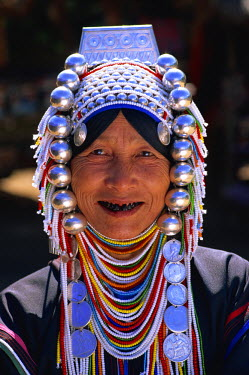 Thailand, Chiang Rai, Akha Hilltribe Woman Wearing Traditional Silver Headpiece