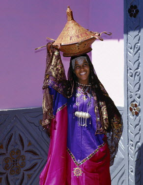ETH1132 Ethiopia, Harerge Province, Harar. An Harari girl in wedding attire. Unlike Muslims elsewhere, Harari women love bright clothes and are seen in public without face veils. The beautifully embroidered s...