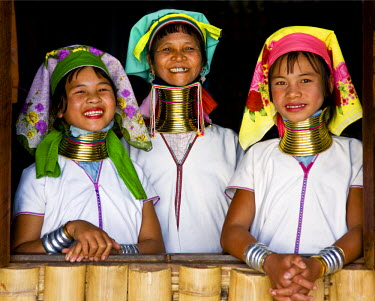Myanmar, Burma, Lake Inle. Happy Padaung women belonging to the Karen sub-tribe wearing their traditional heavy brass necklaces which elongate their necks.