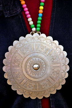 Myanmar, Burma, Namu-op. The detail of a beautiful silver pendant, known as Phè gho, worn by Akha women.