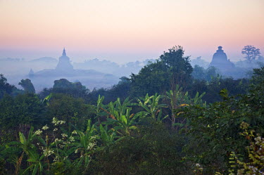 MYA1396 Early morning mist shrouds the historic temples of Mrauk U which were built in the Rakhine style between the 15th and 17th centuries.