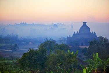 MYA1397 Early morning mist shrouds the historic temples of Mrauk U which were built in the Rakhine style between the 15th and 17th centuries.