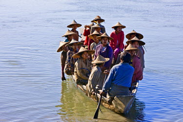 MYA1401 Myanmar, Burma, Rakhine State, Gyi Dawma. In the early morning, the women of Gyi Dawma village cross the Kaladan River by boat to tend their fields on the far side.
