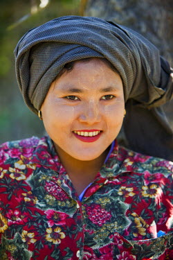 MYA1408 Myanmar, Burma, Rakhine State, Laung Shein. An attractive girl from Laung Shein village. Her face is decorated with Thanakha, a local sun cream and skin lotion.