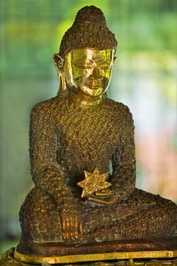 MYA1428 Myanmar, Burma, Rakhine State, Sittwe. The 18-inch-high Bronze Buddha at Lawkanandar Pagoda is claimed to be 2,000 years old.  It has clothing made up of 1,162 small Budhha images.