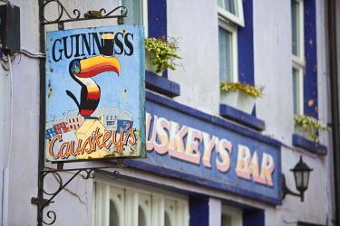 IE02168 Pub Sign, Eyeries Village, Beara Peninsula, Co. Cork & Co. Kerry, Ireland