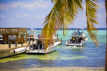 CA42_GJO0084_M Dive boats, Little Cayman Beach Resort, Little Cayman, Cayman Islands, Caribbean.
