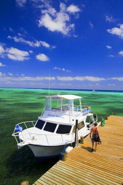 CA42_GJO0095_M Dive boats, Little Cayman Beach Resort, Little Cayman, Cayman Islands, Caribbean.