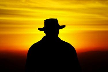 AU01_DWA1478_M Man in Akubra at Sunrise, Mount Buffalo National Park, Victoria, Australia
