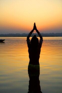 AS10_KSU0133_M Worship ceremony at night by Ganges River, Varanasi, India