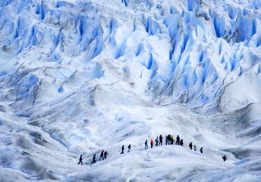 SA01_BJA0032_M Argentina, Santa Cruz. Hikers on the blue ice of the Perito Moreno Glacier.