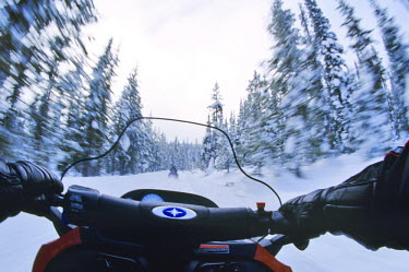 LI06_CHA0005_M Riders perspective of a snowmobile ride.