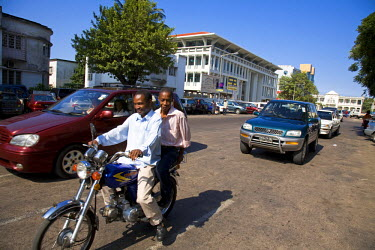 MOZ1274 Mozambique, Maputo. Cars and a motorbike travel down Avenida S Machel in the Baixa district of downtown Maputo. Maputo is the capital of Mozambique. It is a bustling, attractive port city with a popul...