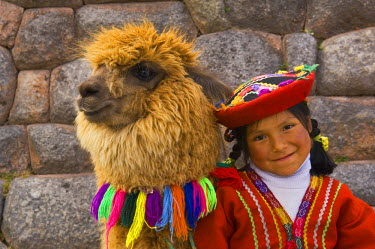 SA17_BJA0036_M Peru, Cusco, Portrait of young girl in colorful native dress with baby alpaca